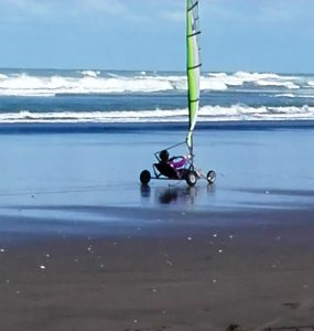 Me, whizzing through the wet sand!